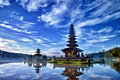 View of a hindu temple on lake during sunrise in bali indonesia Royalty Free Stock Photo
