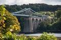 A view of the historic Menai suspension bridge spanning the Mena Royalty Free Stock Photo