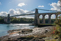 A view of the historic Menai suspension bridge spanning the Mena Royalty Free Stock Photo