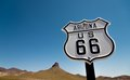 A view of a historic Route 66 sign with a sky blue background Stock Images