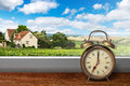 View of house on summer vineyard landscape from window with alar alarm clock Stock Images