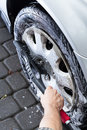 View of hubcap cleaning vertical hand during Stock Photo