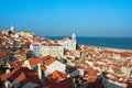 View of igreja de santo estevao in alfama lisbon panoramic toward a church portugal and the tagus river a bright sunny day Royalty Free Stock Images