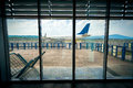View from inside of airport on the plane on runway Royalty Free Stock Photo