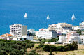 view of Karistos city and three sailboats in a row Royalty Free Stock Photo