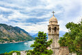 View of Kotor city, Church of Our Lady of Remedy, mediterranean sea and mountain landscape in Bay of Kotor, Montenegr