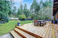 View of large back deck with outdoor furniture Royalty Free Stock Photo