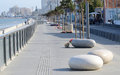 View of Larnaca seafront with palm trees and stone shaped benches Royalty Free Stock Photo