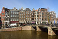 View of Leliegracht bridge spanning Prinsengracht canal in Amsterdam. Royalty Free Stock Photo