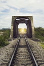 View of the length of railway and old steel bridge,filtered image,light effect ,There light at the end of the tunnel,s Royalty Free Stock Photo