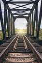 View of the length of railway among old steel bridge Royalty Free Stock Photo