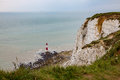 View of the lighthouse at Beachy Head in Sussex showing the tide Royalty Free Stock Photo