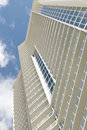 View looking up to sky along generic high rise building Royalty Free Stock Photography