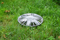 View of lost hubcap on the grass Stock Photo