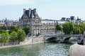 View of louvre from the river seine paris france Royalty Free Stock Image
