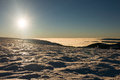 View of a low clouds and sunset on winter mountain ridge Royalty Free Stock Photo