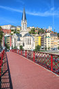 View of lyon city with red footbridge on saone river Stock Photos