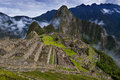 View of Machu Picchu and the surrounding mountains above the Sacred Valley, in Peru Royalty Free Stock Photo