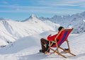 View of man resting on chair in mountains Royalty Free Stock Photo