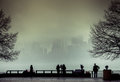 View of Manhattan, New York, from Liberty Island in a foggy day.