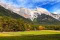 View of Mieminger Plateau with high mountain range in the background, Austrian landscape, Tyrol Royalty Free Stock Photo