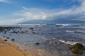 View of molokai waves furl up near a maui beach with a the island Royalty Free Stock Photography