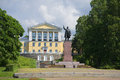 View of the monument to Lenin on a background of an urban high school in Zelenogorsk Royalty Free Stock Photo
