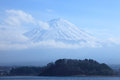 View of mount fuji from kawaguchiko lake in march snow capped with clear sky background Stock Images