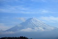 View of mount fuji from kawaguchiko lake in march snow capped with clear sky background Stock Photos