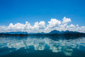 View of mountain and cloud reflections in lake. Royalty Free Stock Photo