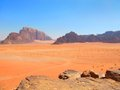 View of mountains and desert in wadi rum jordan beautiful scenic distant blue mountain range colorful Royalty Free Stock Photos