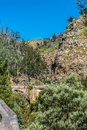 View of mountains and a old roman bridge over Paiva river, in stone, with vegetation around Royalty Free Stock Photo