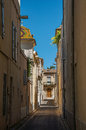 View of a narrow alley with sunny blue sky, in the city center of Nimes. Royalty Free Stock Photo