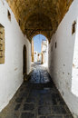 View of narrow street through the arch a island an Royalty Free Stock Photography