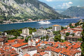 View of navy pier with the cruise ship and the rooftops of the o old town kotor montenegro Royalty Free Stock Photos