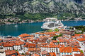 View of navy pier with the cruise ship and the rooftops of the o old town kotor montenegro Stock Photo