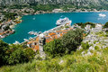 View of navy pier with the cruise ship and the rooftops of the o old town kotor montenegro Stock Image