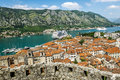 View of navy pier with the cruise ship and the rooftops of the o old town kotor montenegro Stock Photography