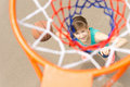 View through the net of a basketball shooter Royalty Free Stock Photo