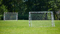 View of a net on vacant soccer pitch. Royalty Free Stock Photo