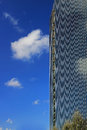 View of new highrise office building against blue sky with cloud reflections Royalty Free Stock Photo
