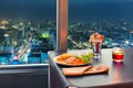View at night bangkok from restaurant window Stock Photography