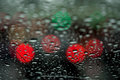 View of the night city through the window on a rainy night, raindrops fall on the windshield of the car. Concept life of Royalty Free Stock Photo