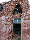 View of the old Augstroze manor, half-ruined side of red bricks, empty windows Royalty Free Stock Photo