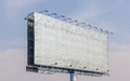 The view of old blank advertising billboard with blue sky backgr Royalty Free Stock Photo