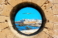 View of the old city through the fortress wall. Essaouira. Morocco Royalty Free Stock Photo