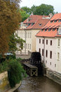 View of old Prague watermill wheel Stock Photos