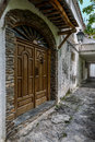 View of an old and rustic wooden door of a village house Royalty Free Stock Photo