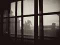 View from an old window. Sepia photo. Royalty Free Stock Photo