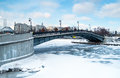 View of one of the many bridges crossing the moskva river in moscow during winter time with a frozen river Stock Images
